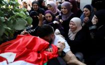 Palestinians bid farewell to mother killed in zionist forces raid