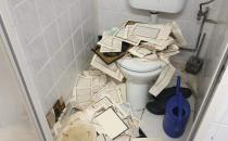 Scandalous event in Germany: they tear down the Qur'an and throw it to the toilet