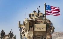 US forces leaving Syria don't have permission to stay in country, Iraq military says